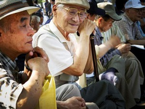 Older persons sitting in an event