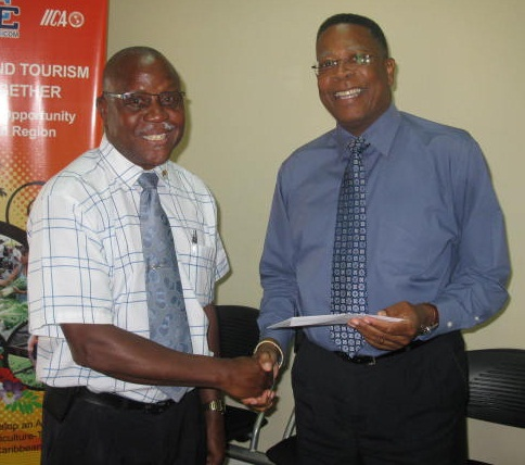 Victor Felix Deputy Chief Labour Officer receive his  travel documents, from OAS Representative Francis McBarnette before leaving to attend the Inter-American Conference of Ministers of Labor (IACML)  in Nassau, The Bahamas, from April 16 to 19, 2013, on the behalf of the Government of Barbados