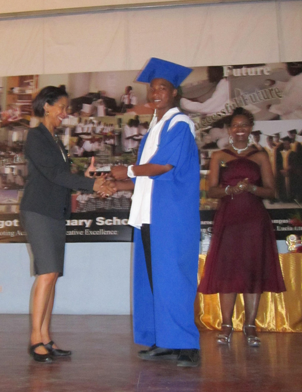 OAS Representative presents Certificates at C.A.R.E.'s Graduation Ceremony
