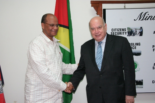 H.E. J. Insulza, Secretary General (SG) of the OAS (at right) meets with the Hon. Clement Rohee, Minister of Home Affairs of Guyana at the Ministry.