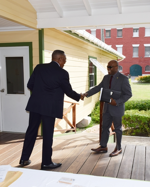 OAS Country Representative Francis McBarnette, greets Hon. Edmund Hinkson, Minister of Home Affairs ahead of the opening of the Barbados National workshop on gender equality in counter-drug enforcement agencies  GENLEA/OAS CICAD, at the Barbados Defence Force, St. Ann's Fort the Garrison
