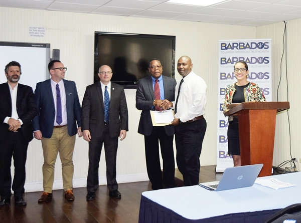 The awarding of certificates by OAS Representative Mr. Francis McBarnette, at the OAS CICTE Tourism Security Workshop at the Barbados Defence Force (BDF) headquarters June 30 2017