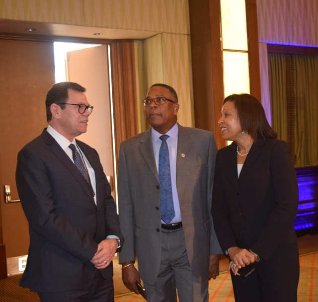 Dr. Wm Warren Smith, President of the Caribbean Development Bank (left) meet with Mr. Francis McBarnette, OAS Barbados Representative and the Executive Secretary for Integral Development for the OAS, Ms. Kim Osborne ahead of the opening of the Caribbean Development Bank (CDB) Conference entitled Caribbean leadership and Transformation Forum: Delivering Results at the Hilton Barbados.