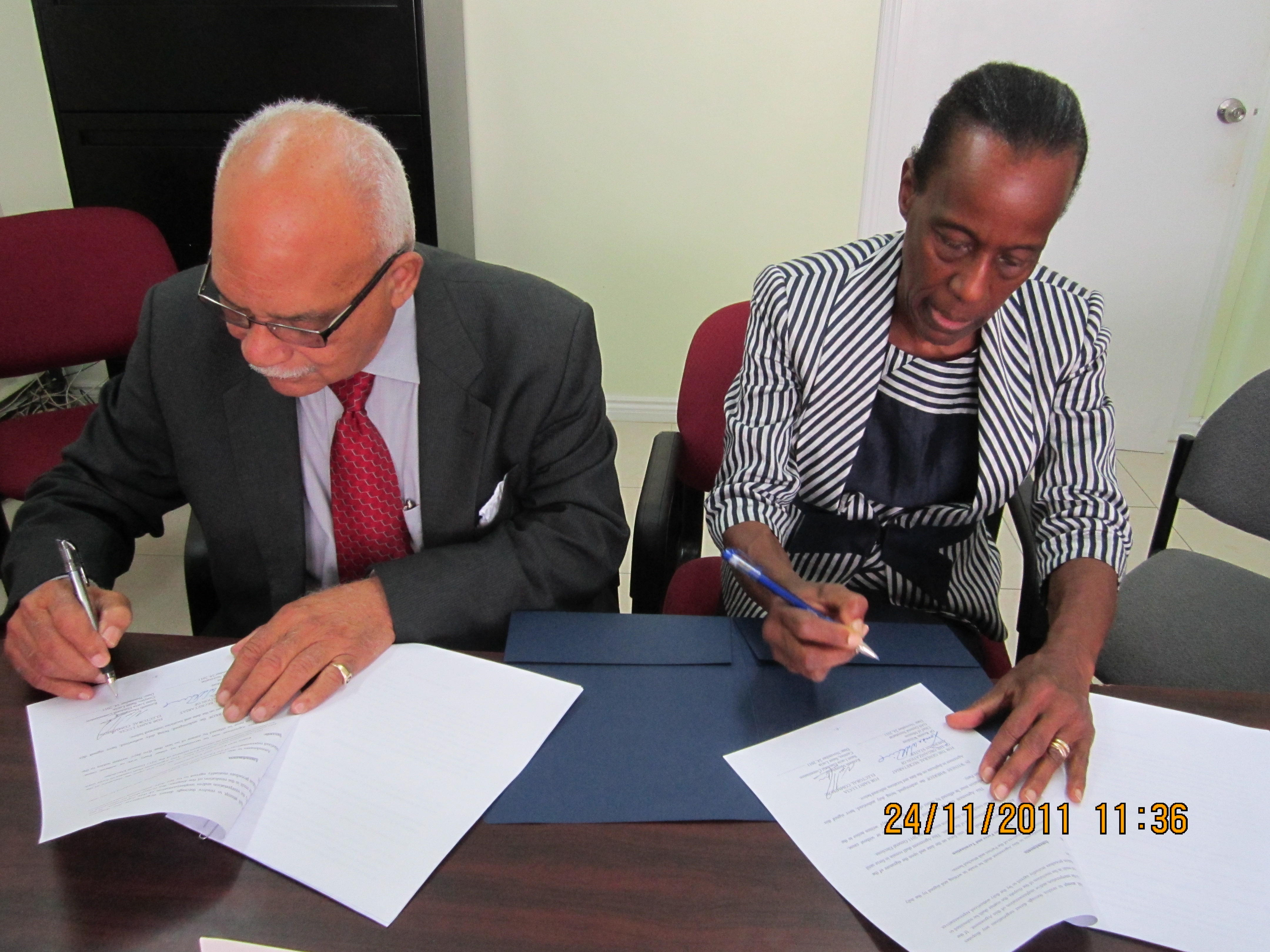 Chief of Mission signs Agreement with Chair Electoral Commission
