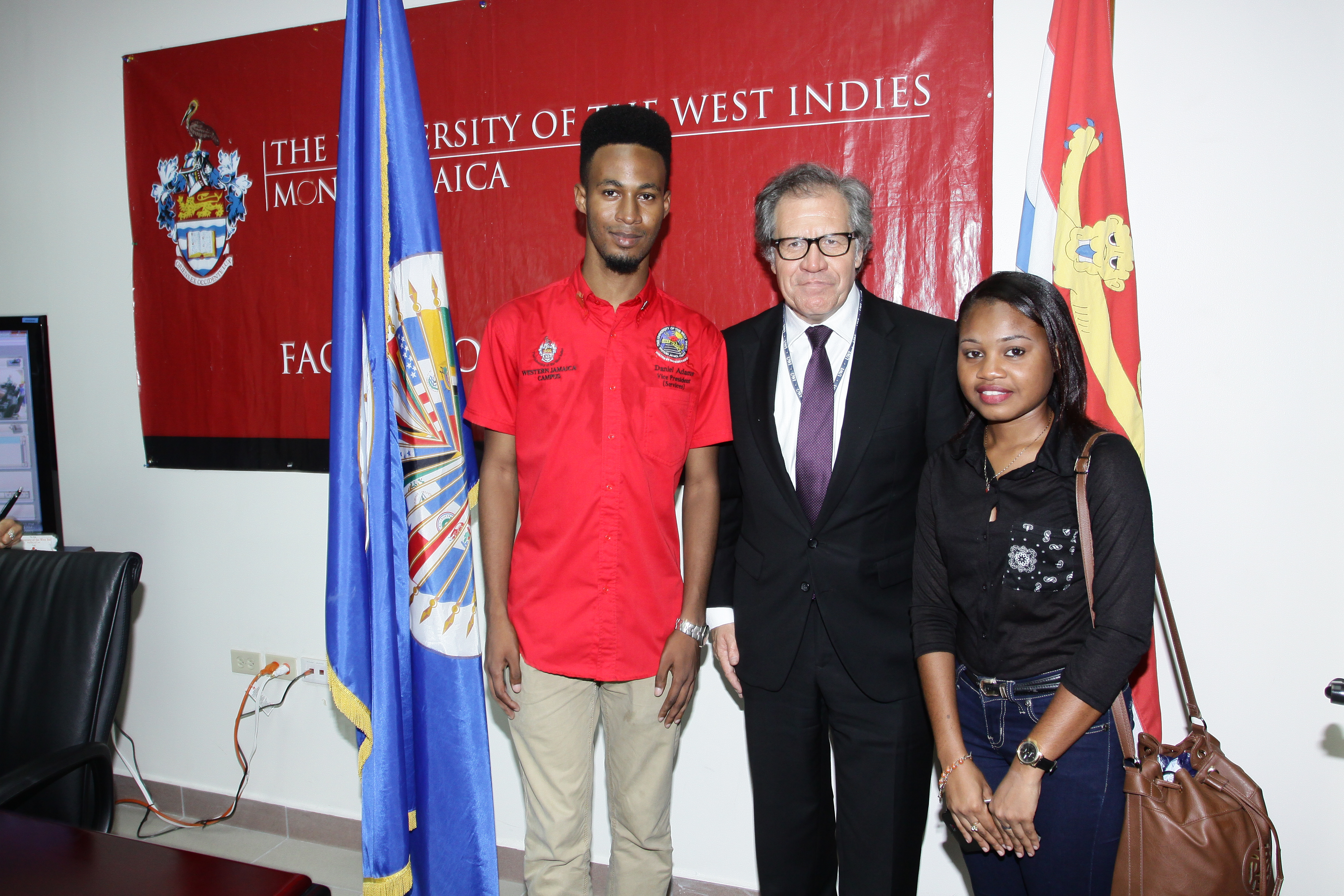 The Secretary General interacts with students during the launch of the  OAS-UWI Partnership on Citizenship Education