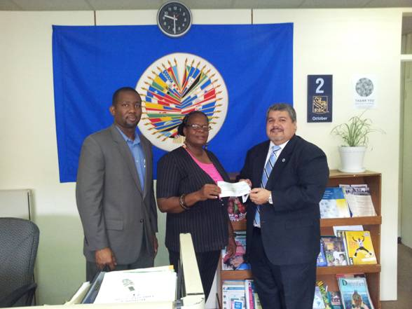 OAS/CICAD handing over a Check to NDPU