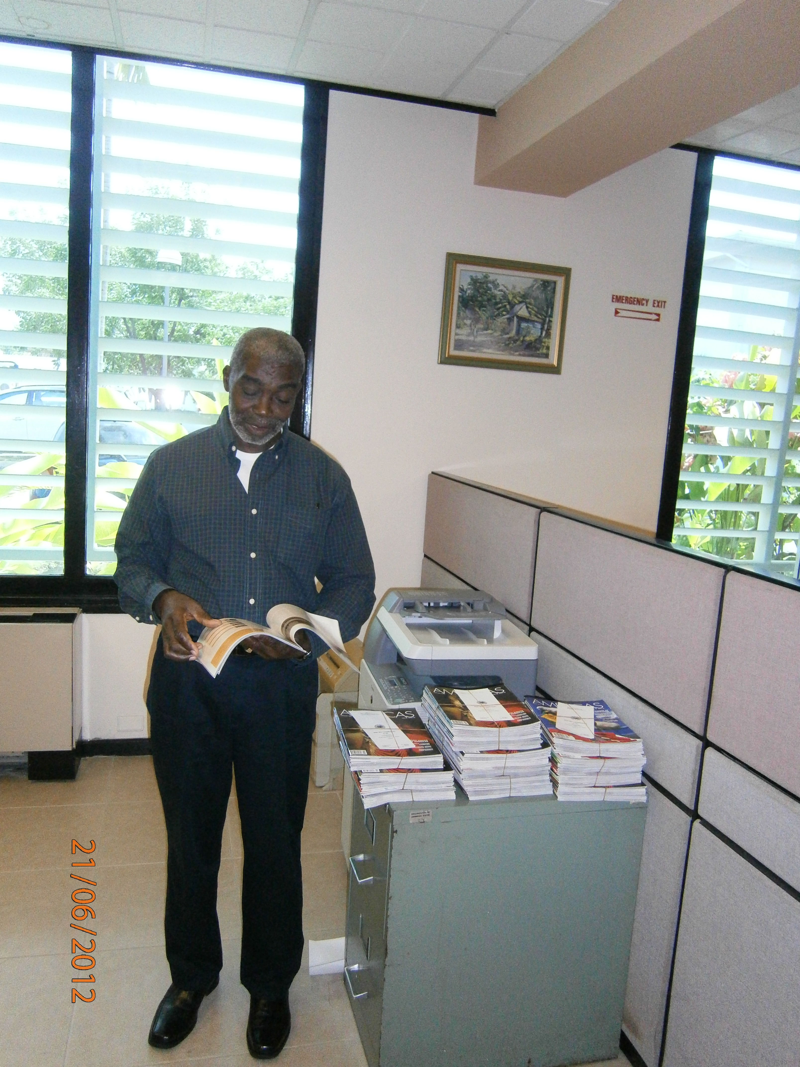 Mr. Lloyd Campbell, OAS Staff and Ms. Soizic Brohan, French intern arranged OAS Americas Magazine for distribution.