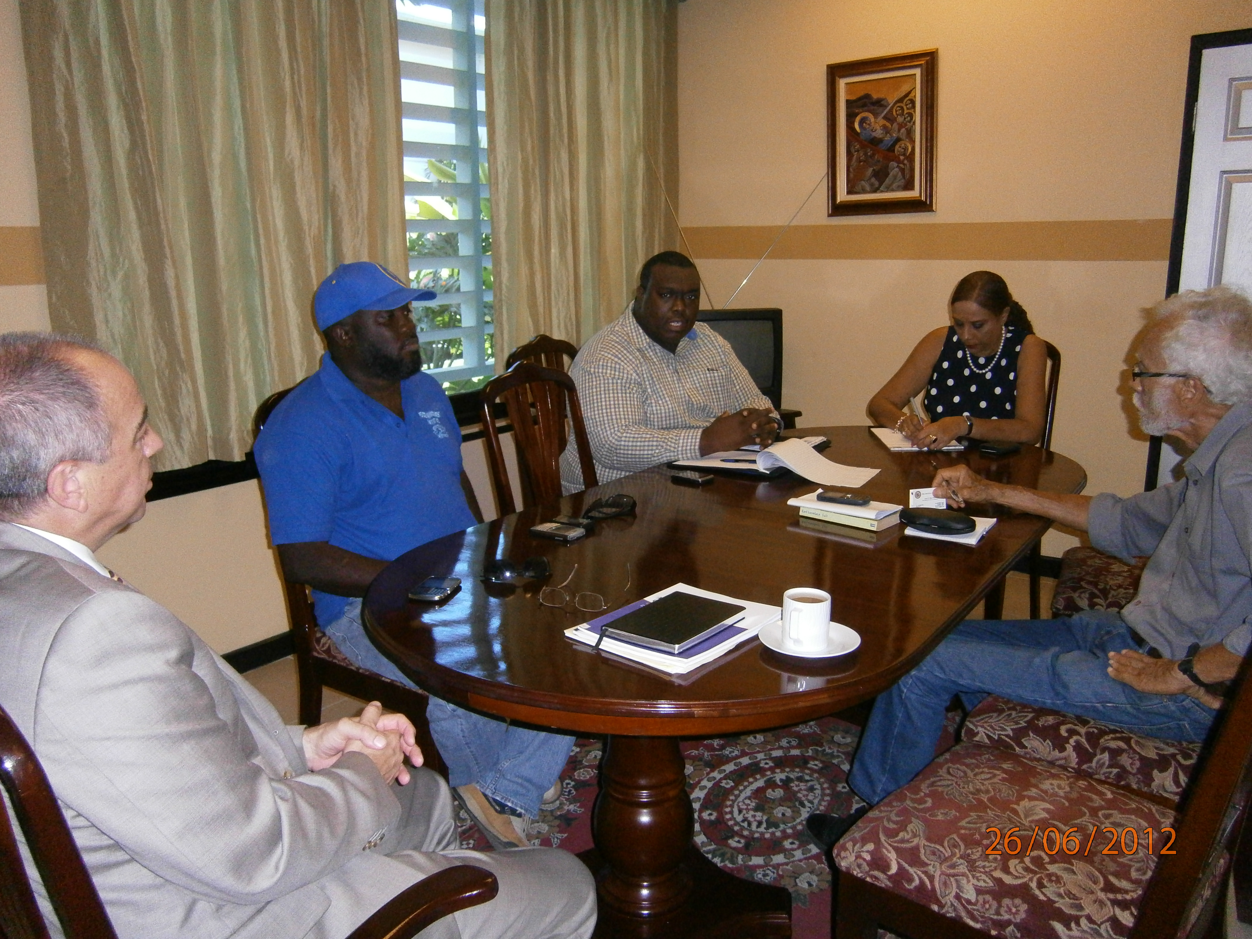 OAS Representative Dr. Joan Neil and PADF Senior Programs Director Mr. Louis Alexander meet with Peace Management Initiative Director Mr. Damion Hutchinson at the OAS Country Office in Jamaica