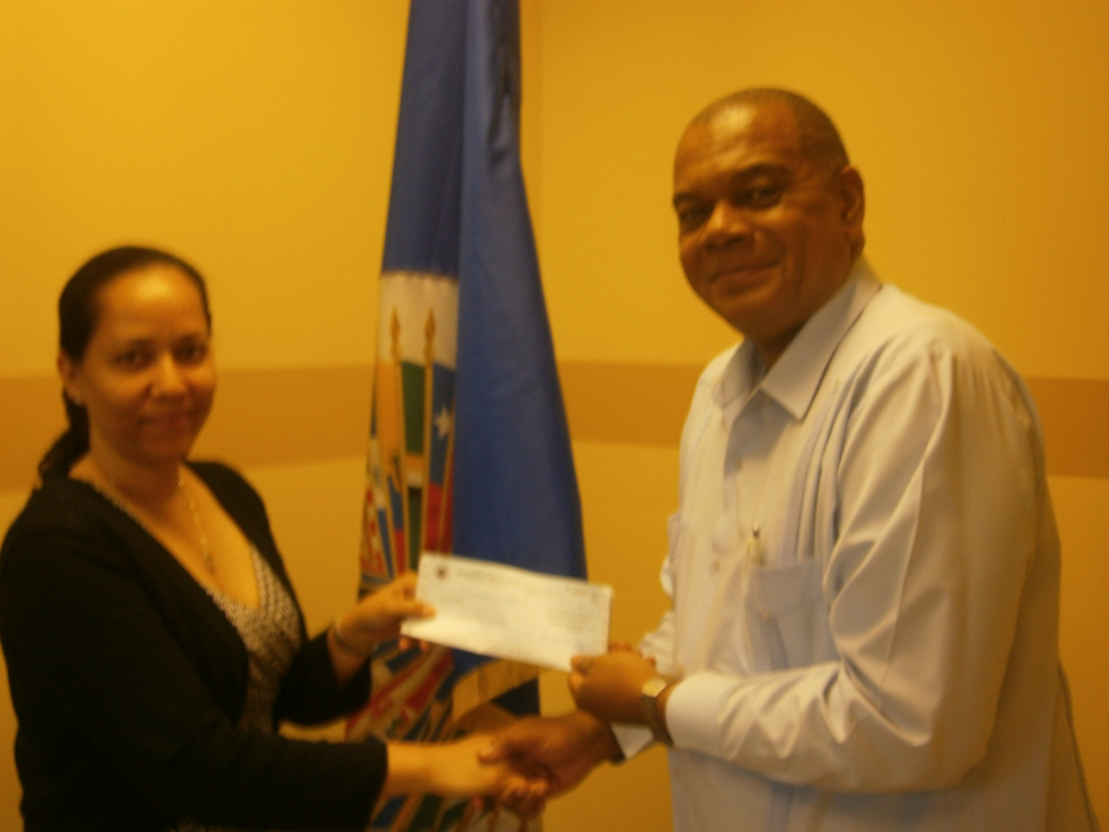 The OAS Representative presented check to Mr. Michael Tucker, Executive Director of National Council on Drug Abuse in accord with MOU between CICAD and Jamaica's National Council on Drug Abuse, to conduct a prison survey on drugs and crime.