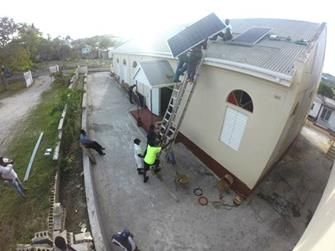 Helping install the solar panels on the congregation's roof