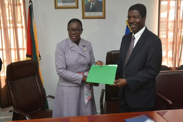 Minister of Education, Nicolette Henry and OAS Country Representative, Jean Ricot Dormeus with the MOU