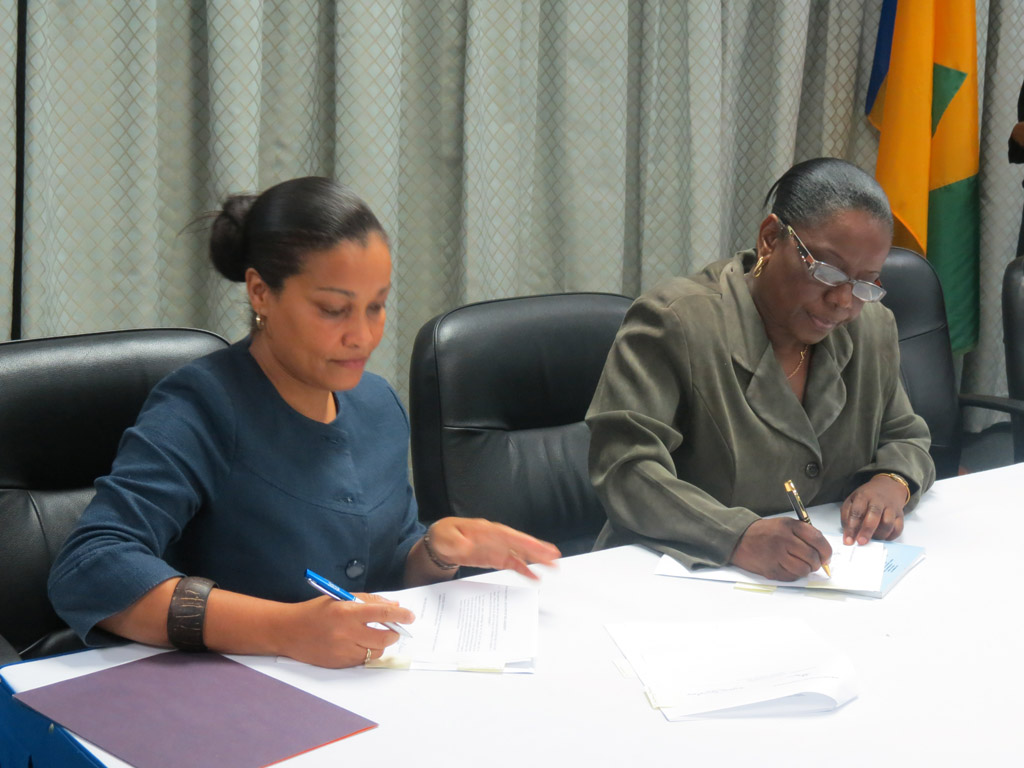 L-R: Laverne Grant, Permanent Secretary, Ministry of Tourism and Laura Anthony-Browne, Director of Central Planning, sign Agreement for the OAS-funded Craft Enhancement project